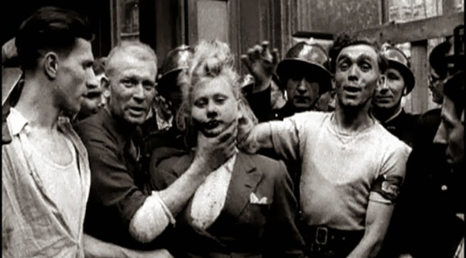 A French woman has her head shaved by civilians as a penalty for having consorted with German troops, 1944 1