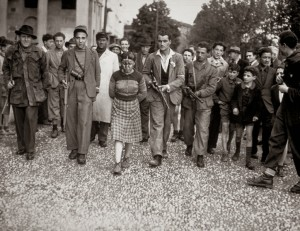 A French woman has her head shaved by civilians as a penalty for having consorted with German troops, 1944 2